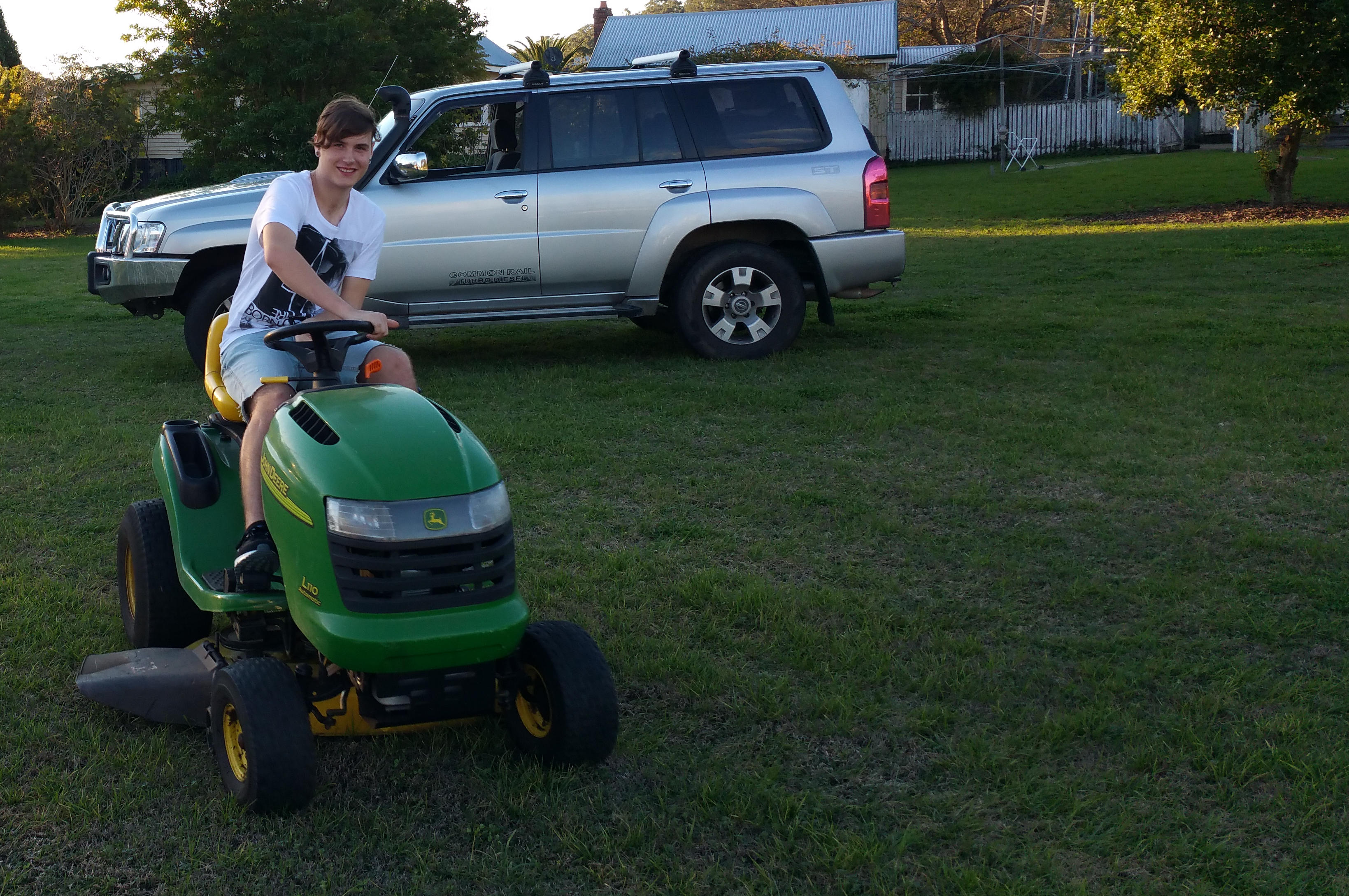 Ash takes the lawn mower for a spin around his uncle's two acres